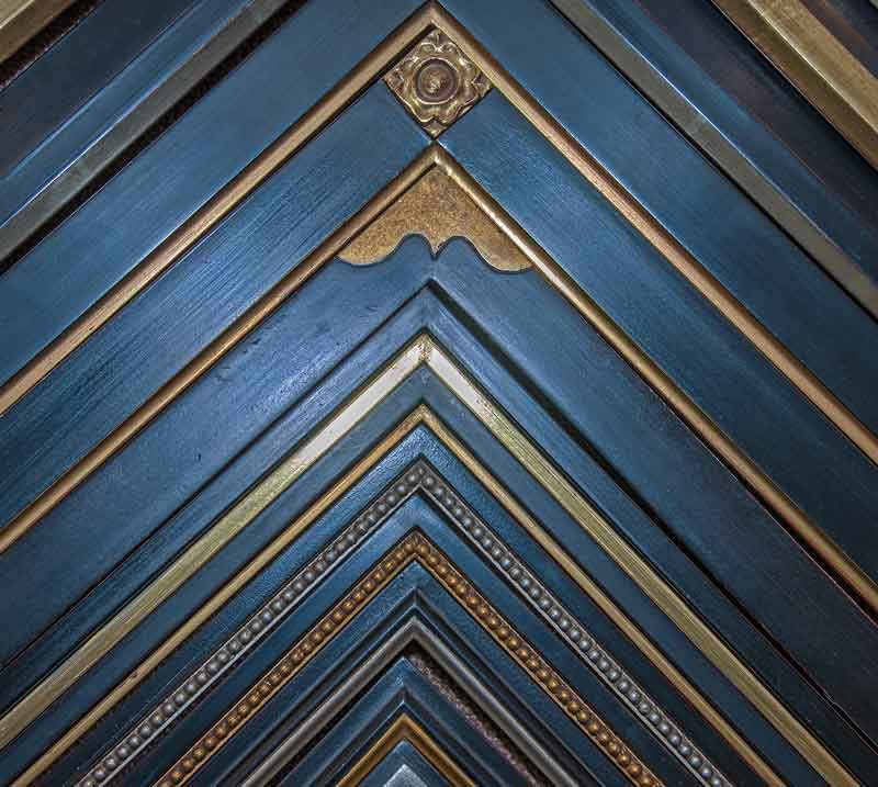 midnight blue custom picture frames with hand carved gold leaf